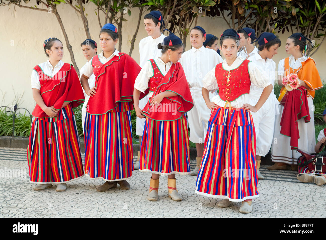 Madeiran children in traditional costume playing musical instruments and dancing, Funchal, madeira - Stock Image