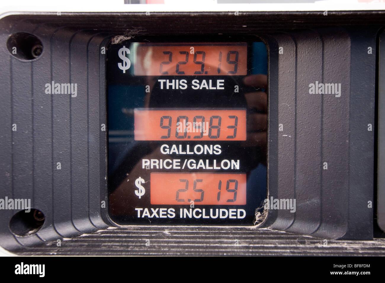 A gas pump displaying a total of $229.19 for gasoline. - Stock Image
