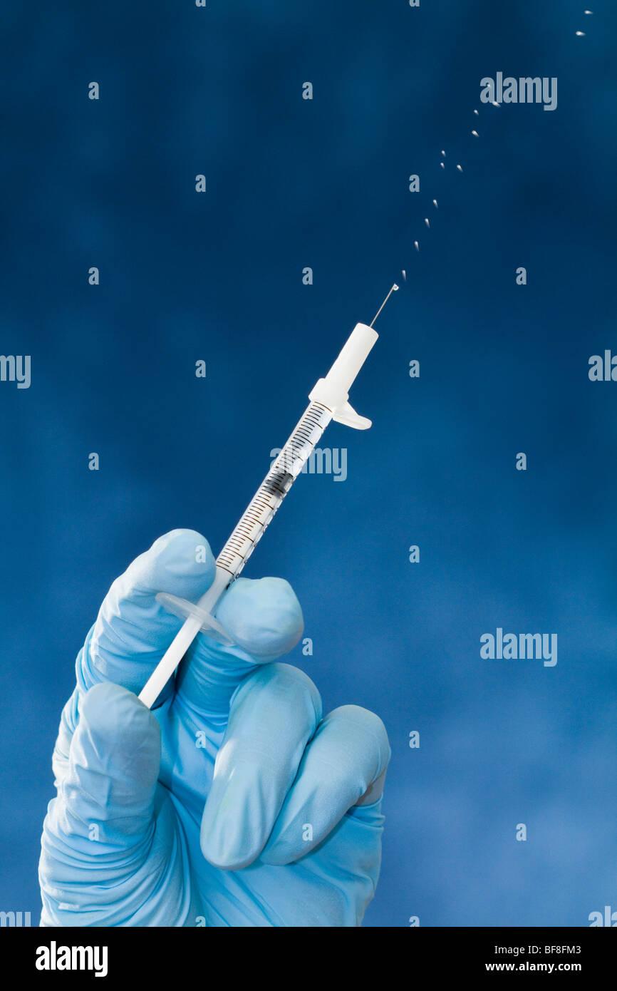 Preparing to give the H1N1 swine flu shot Stock Photo