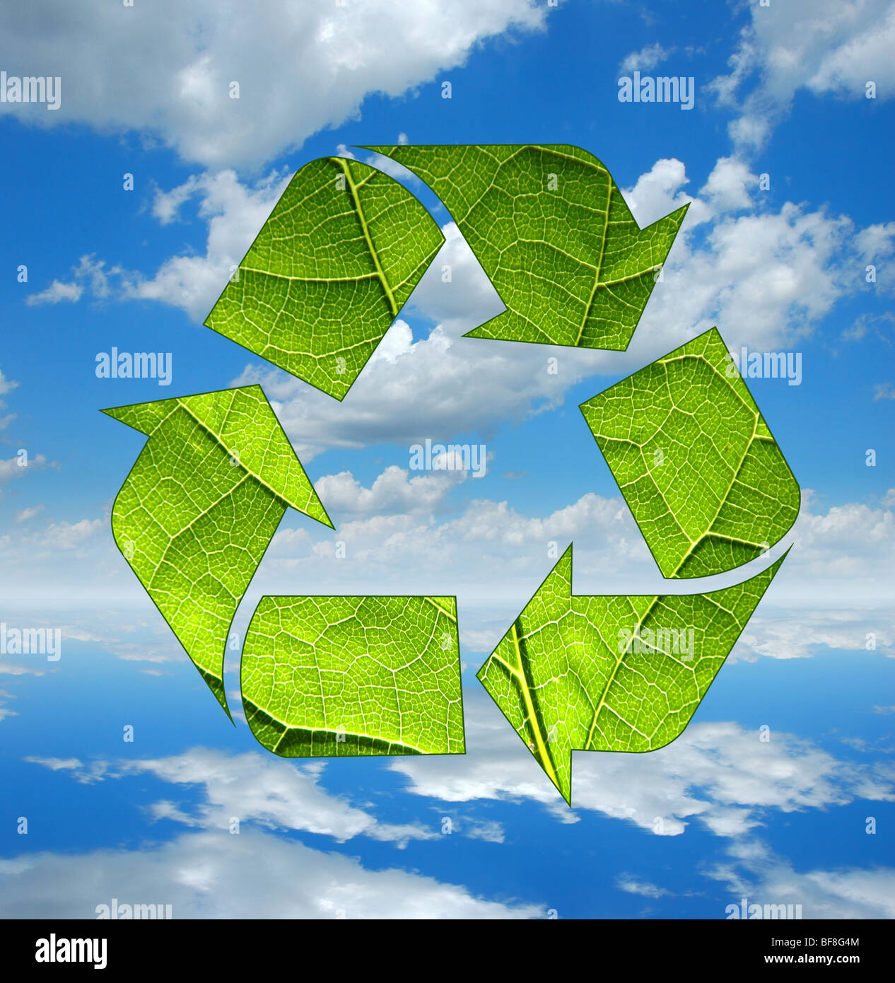 Recycle logo and Clouds and blue sky reflecting on calm waters - Stock Image