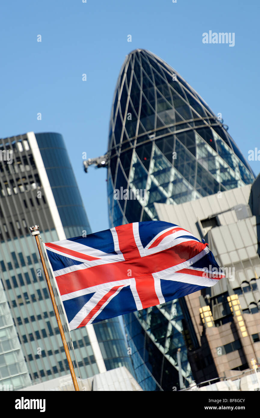 Union Jack flag with the Swiss Re building in the background. City of London. UK 2009. - Stock Image