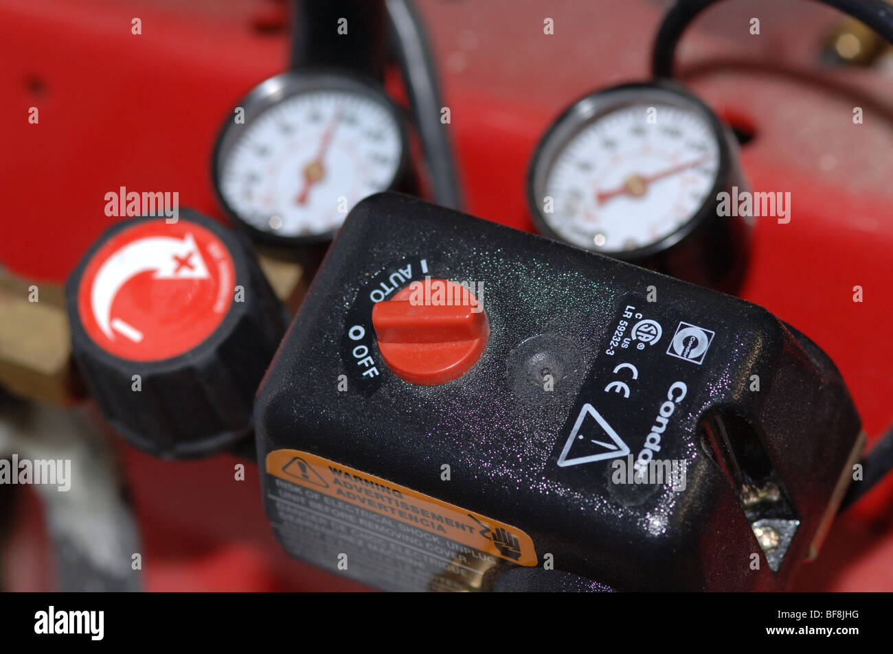 Air compressor gauge and controls Stock Photo