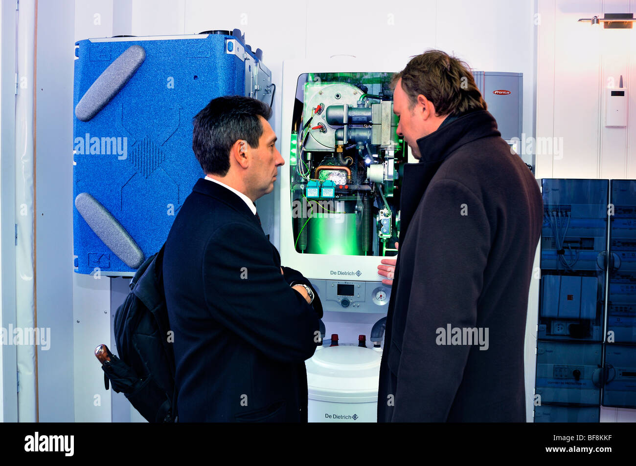 Paris, France, Construction Equipment Trade Show, Boiler, Be-Green Eco-House, Businessmen Talking about Heating - Stock Image