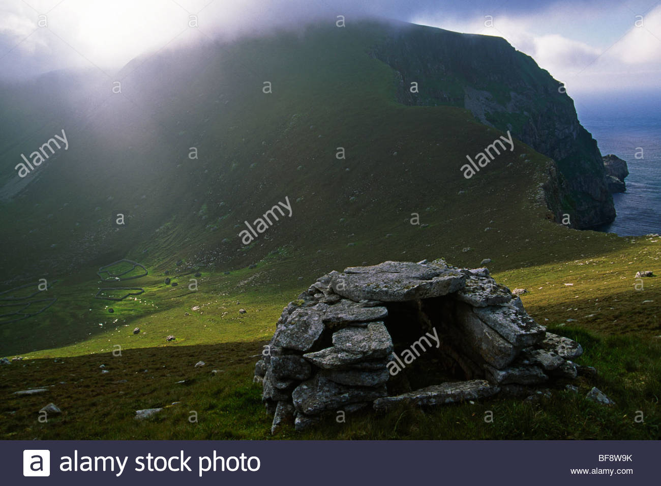 Rock shelters used prehistorically to store seabird harvests, St. Kilda, Scotland - Stock Image