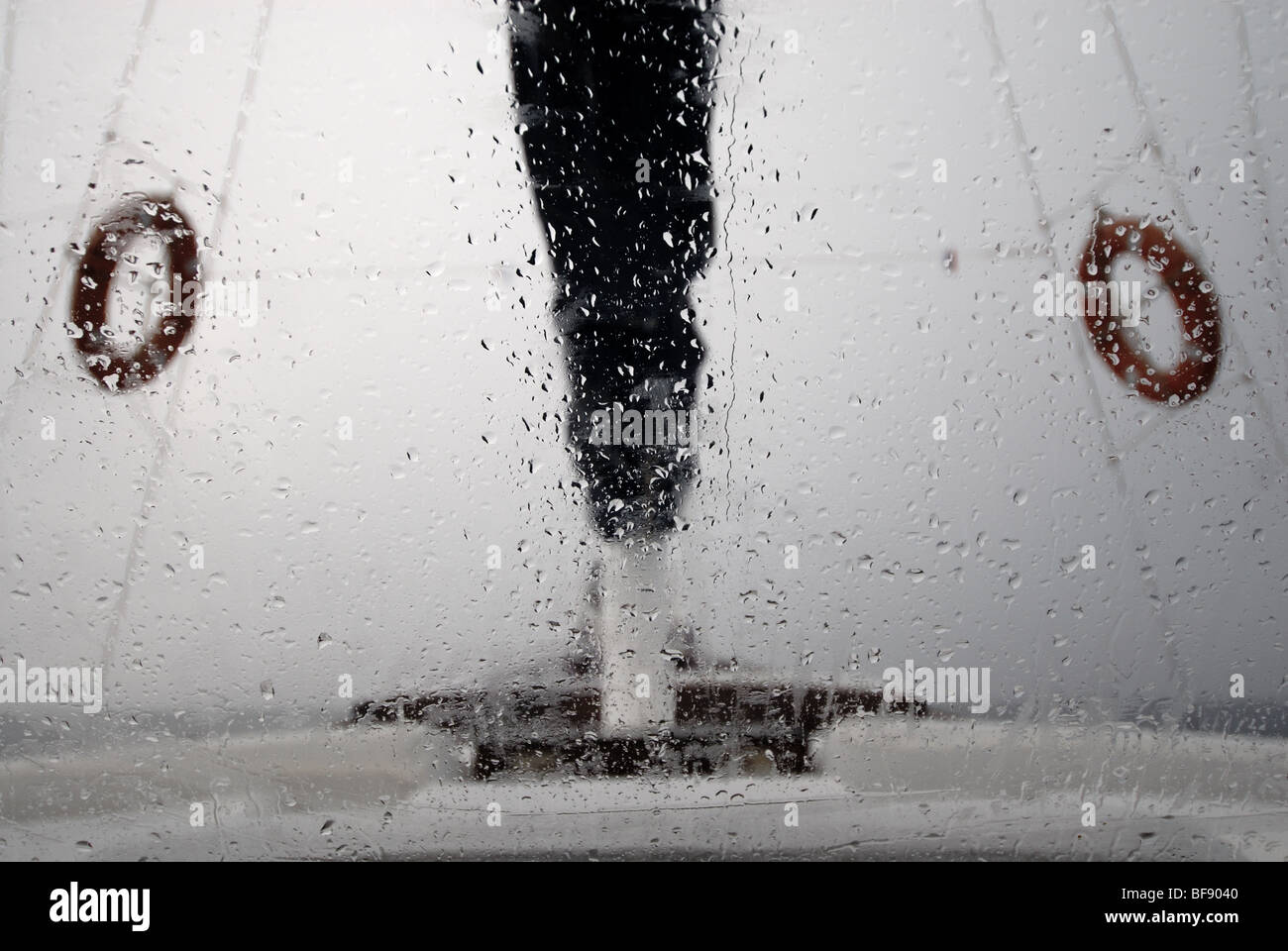 sailboat sailing in the stormy weather - Stock Image