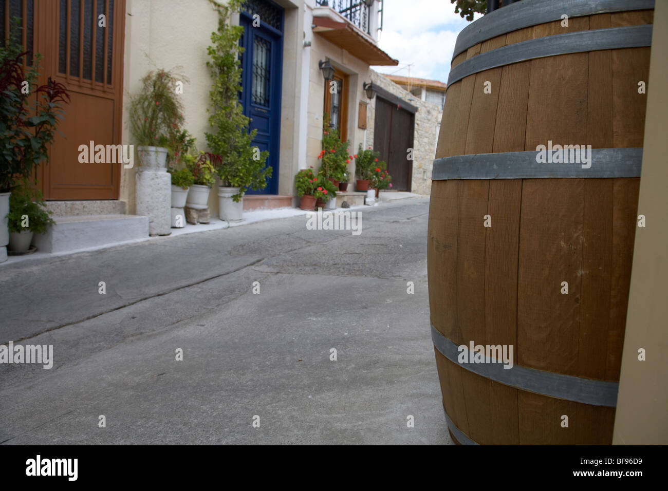 wine barrel in narrow streets of traditional cypriot mountain village omodos village troodos wine region republic - Stock Image