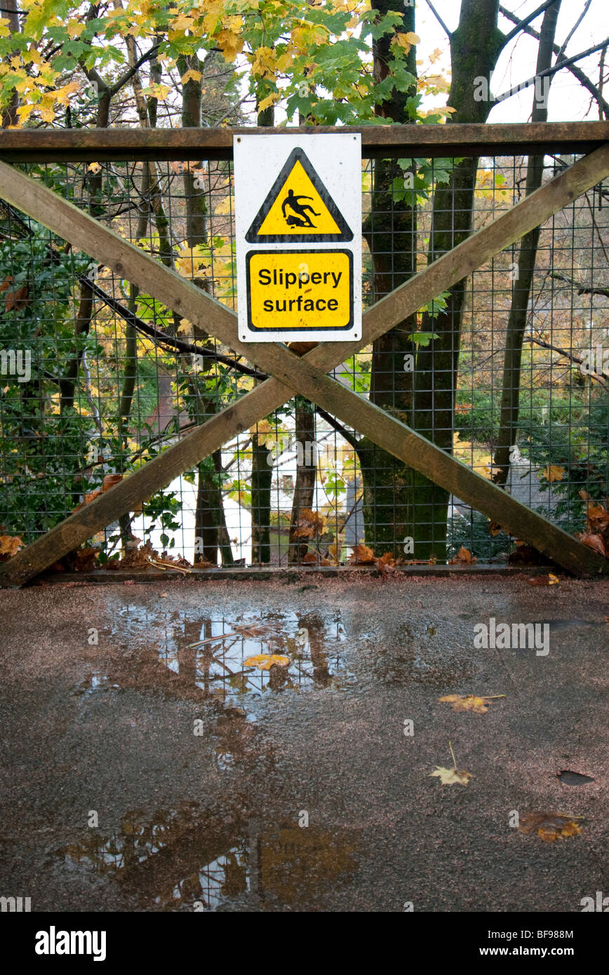wet slippery surface sign - Stock Image