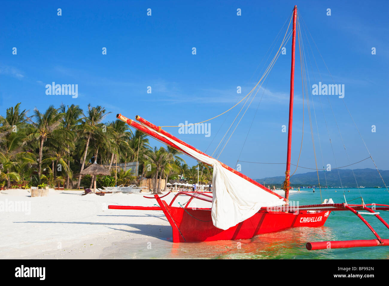 Red boat, white sand and palm trees Boracay; The Visayas; Philippines. - Stock Image