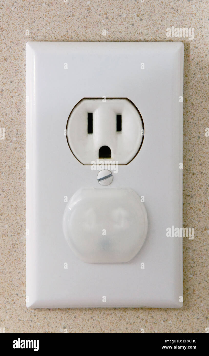 A simple child-proof plug protector is mounted in half of a dual 110 ...
