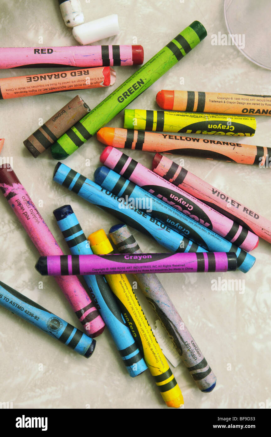 Restaurants often offer crayons in a variety of colors to help keep children in their seats. - Stock Image