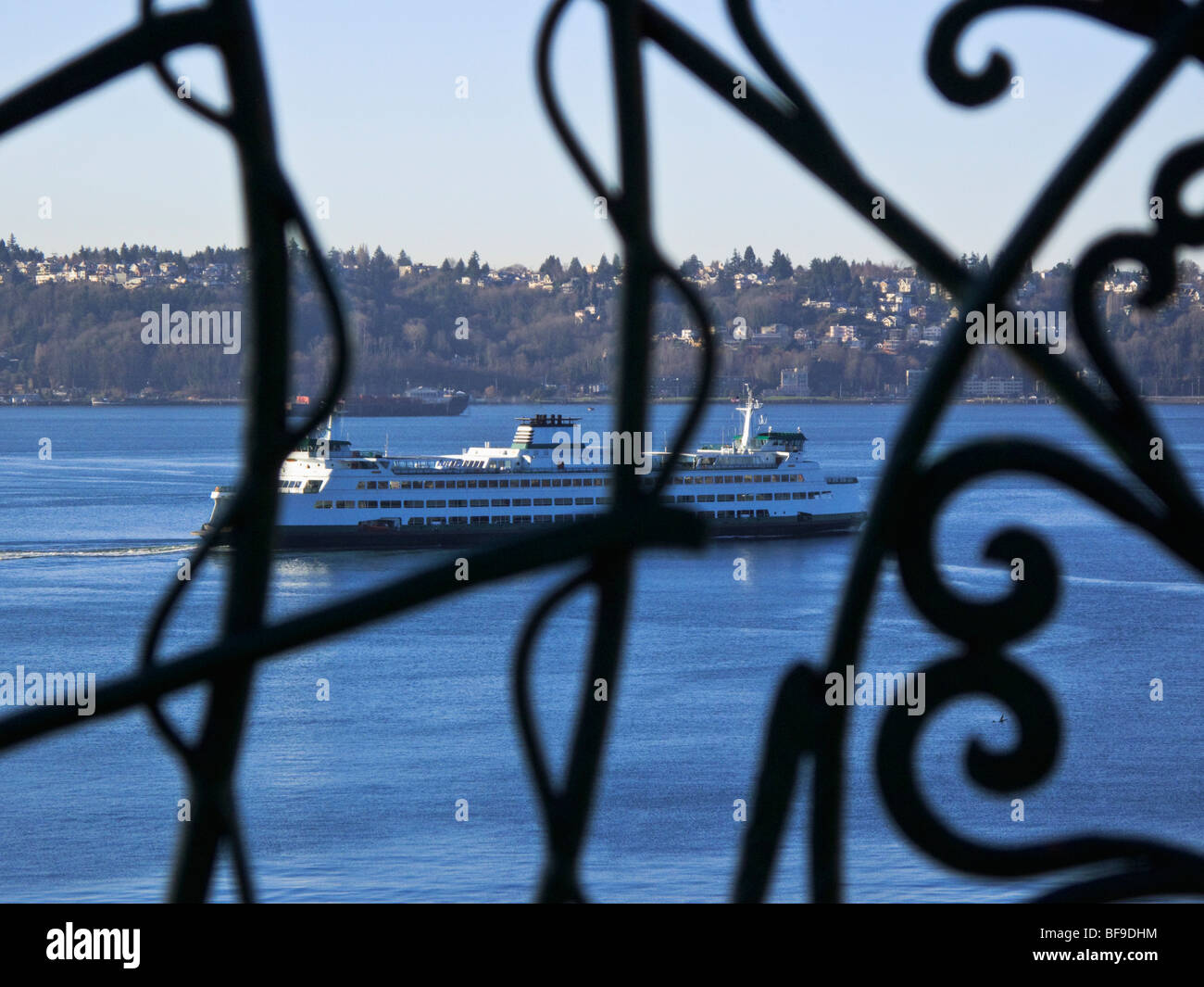 Elliott Bay view through wrought iron fence from Victor Steinbrueck Park, Seattle, Washington - Stock Image
