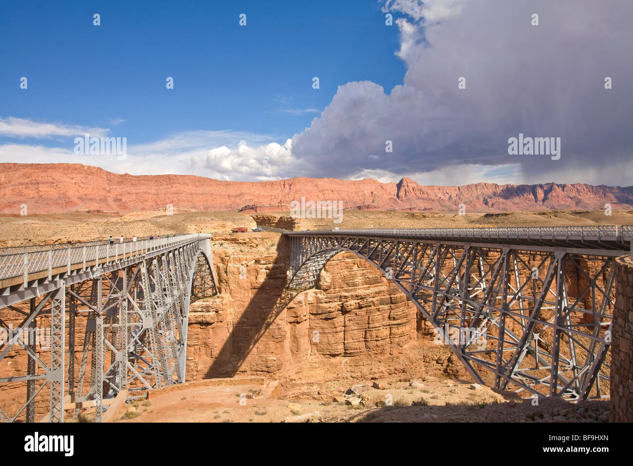 Navajo Bridges old and new over Colorado River on Highway 89A, Marble Canyon, Echo Cliffs in distance, Arizona, - Stock Image