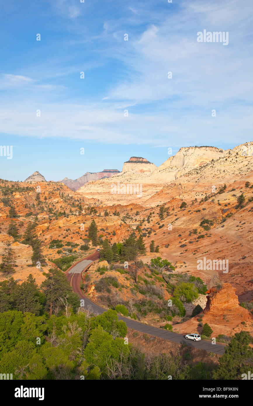 Driving amid the slickrock of Navajo Sandstone, on Zion-Mt. Carmel Highway, near East Entrance of Zion National - Stock Image