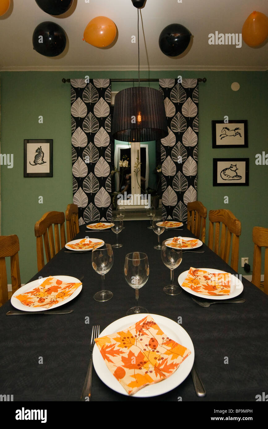 A table set-up for a Halloween dinner party. In the ceiling there ...
