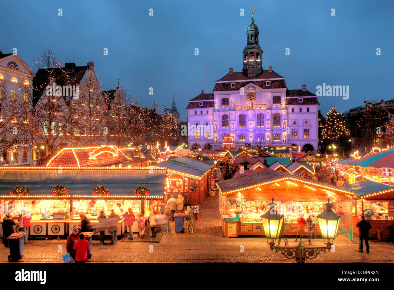 Christmas Market in front of the illuminated town hall of Lueneburg, Lower Saxony, Germany Stock Photo