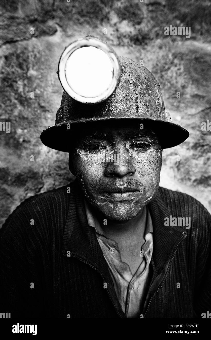 An exhausted miner inside Cerro Rico mountain, Potosi, Bolivia. - Stock Image