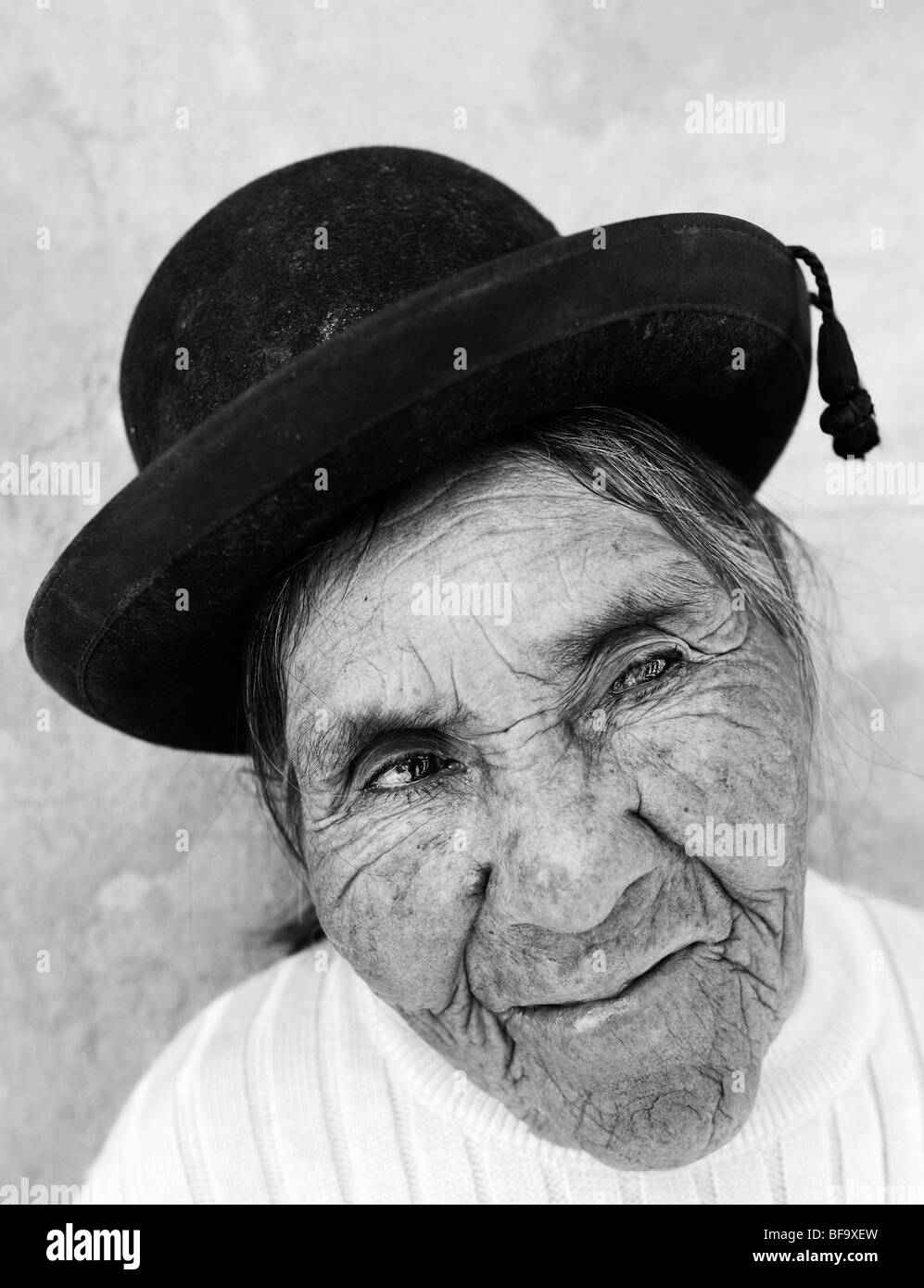 Old Aymara woman with her traditional bowler hat. Salar de Uyuni, Bolivia. - Stock Image
