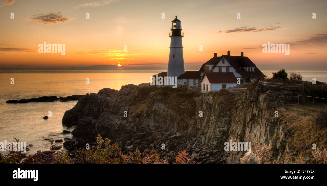 Sunrise at Portland Head Light, which protects mariners entering Casco Bay.  The lighthouse is in Cape Elizabeth, - Stock Image
