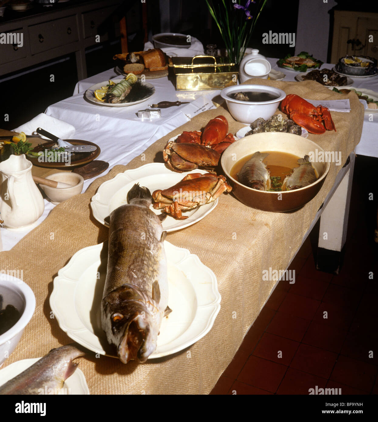 UK, England, Staffordshire, Stafford, Shugborough House Victorian kitchen, fish being prepared for dinner Stock Photo