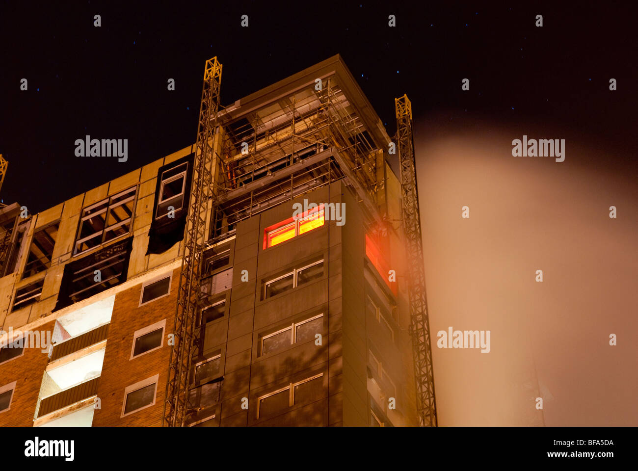 13th Floor flat on fire at night in block of flats - Stock Image
