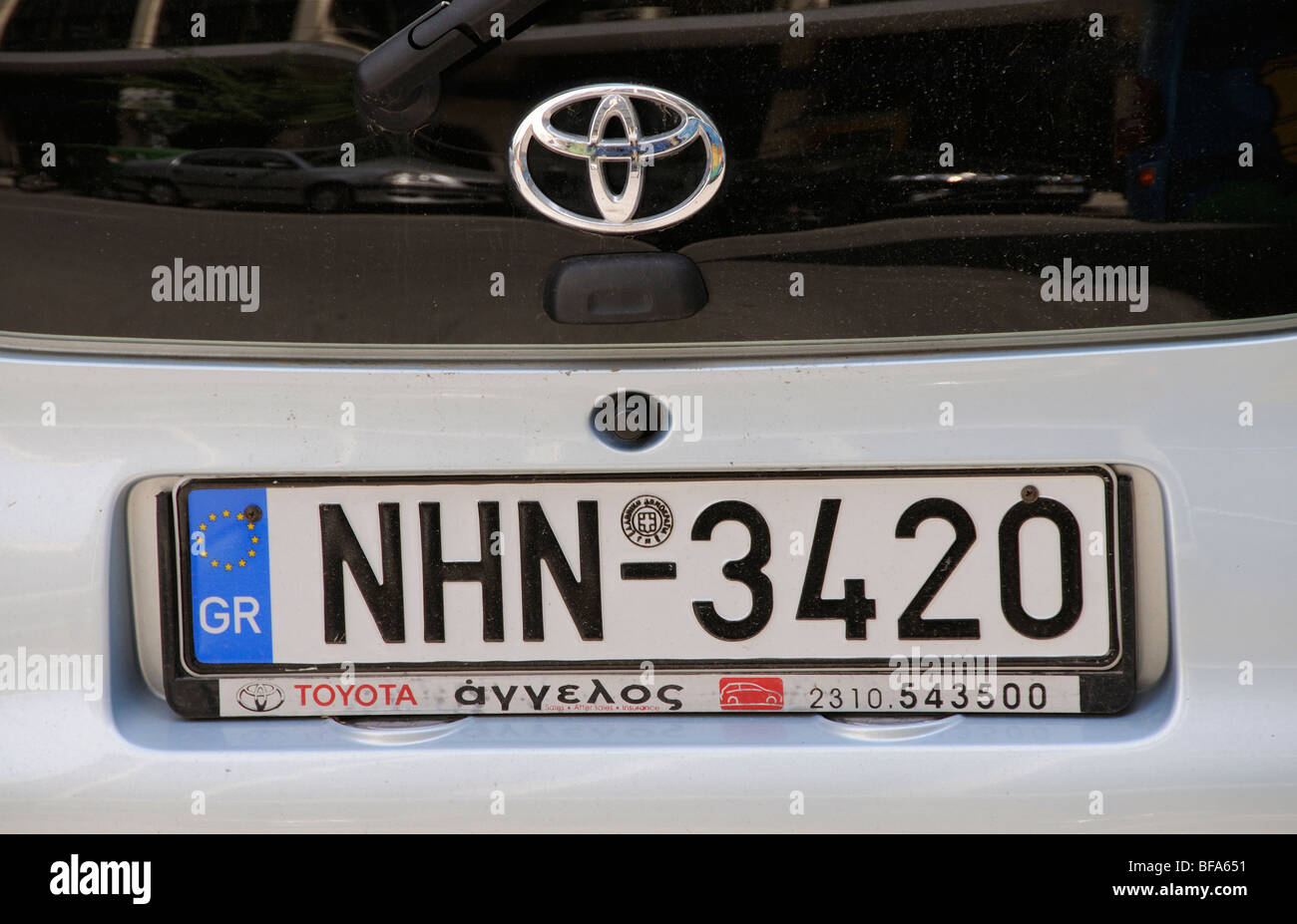 Vehicle registration plate on a Greek Toyota saloon car - Stock Image