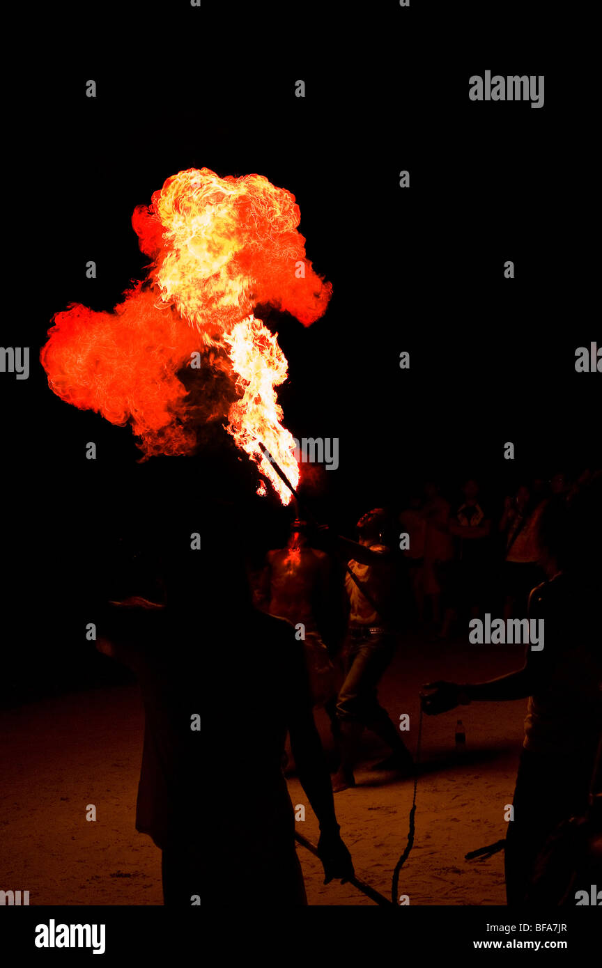 A fire breather performing in Langkawi in Malaysia. - Stock Image