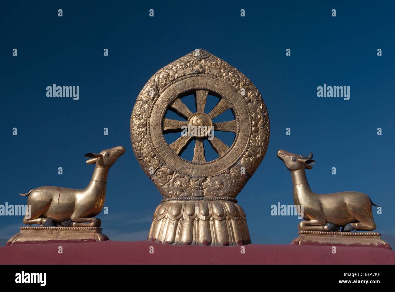 Two deer sit on either side of the wheel of dharma on the roof of the Jokhang Temple in Lhasa Tibet - Stock Image