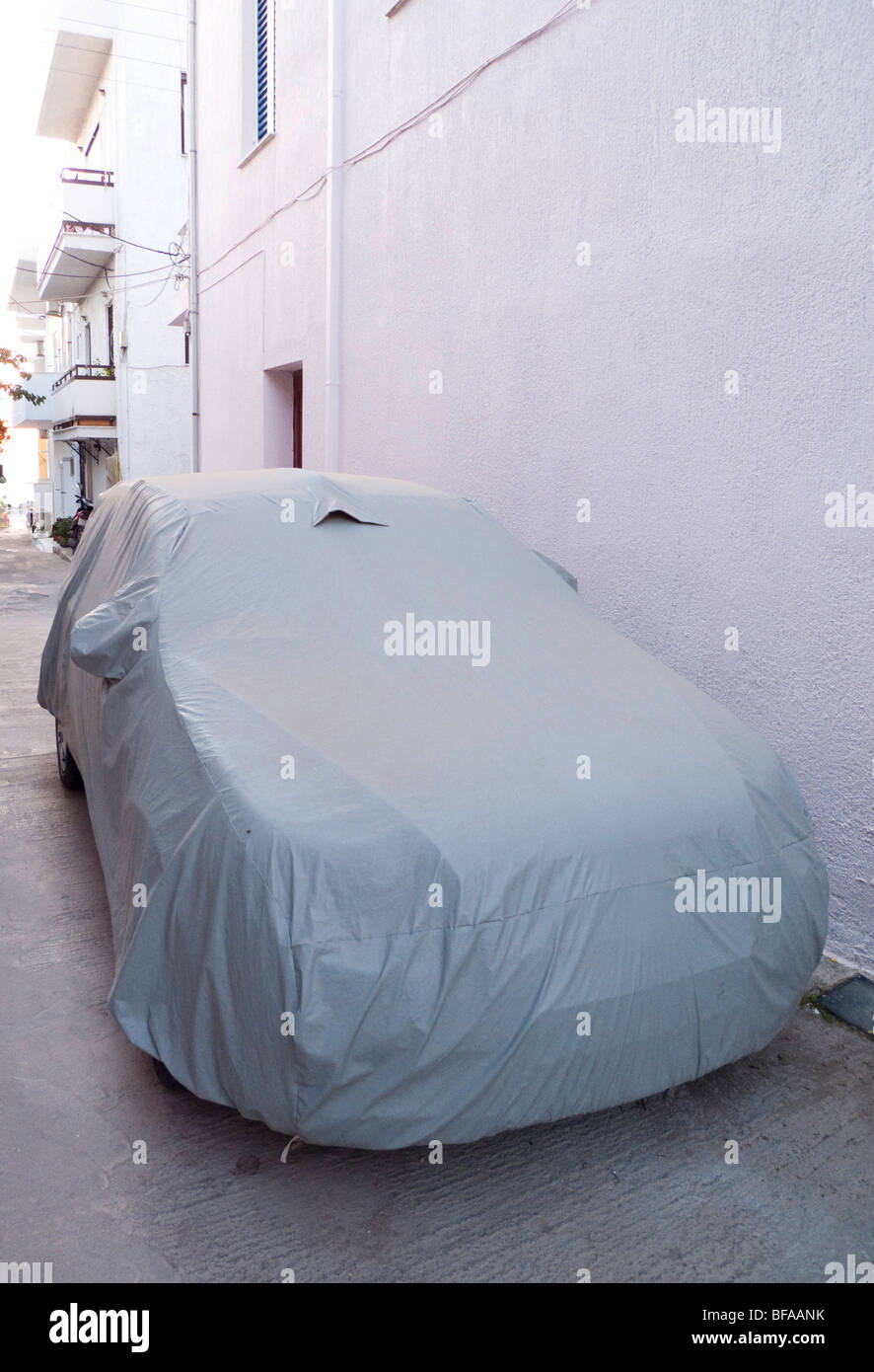 Covered car - Stock Image