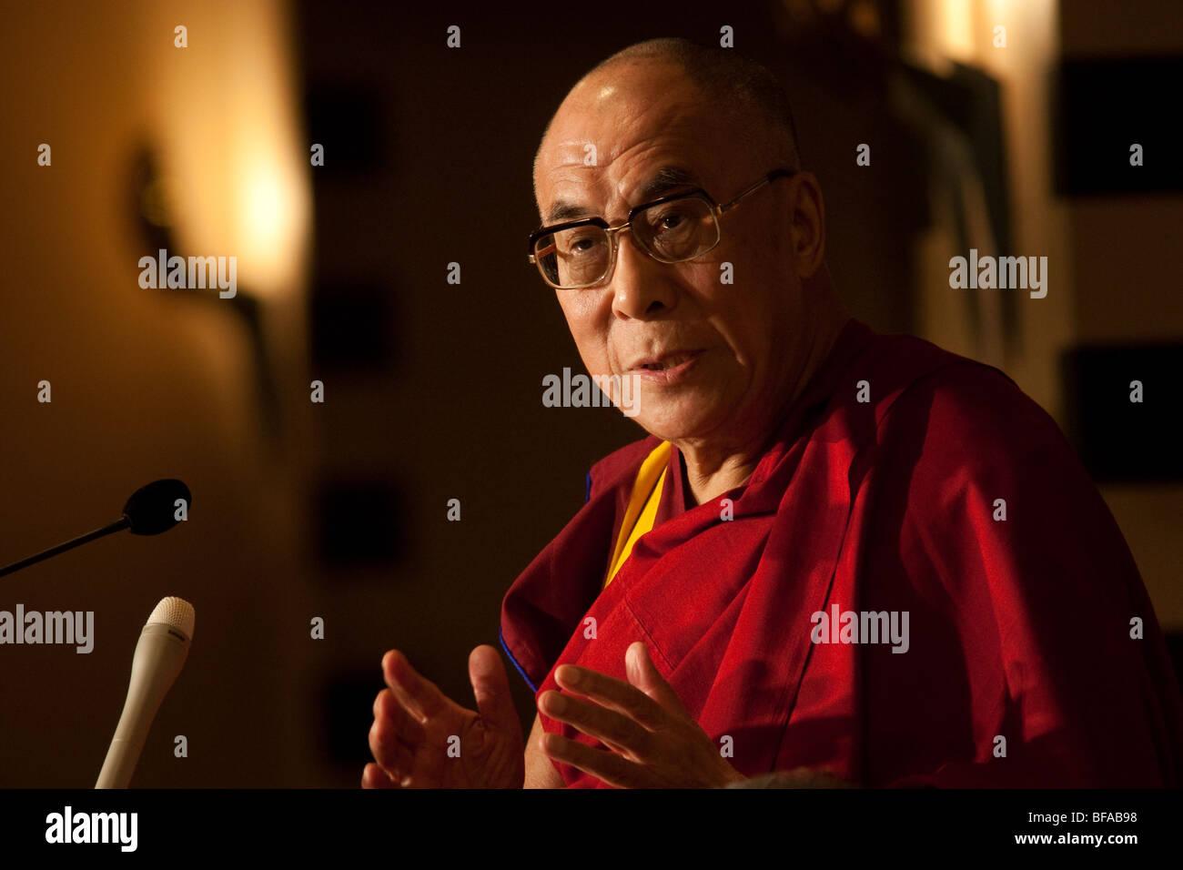 Dalai Lama Tenzin Gyatso, speaking at a function. - Stock Image