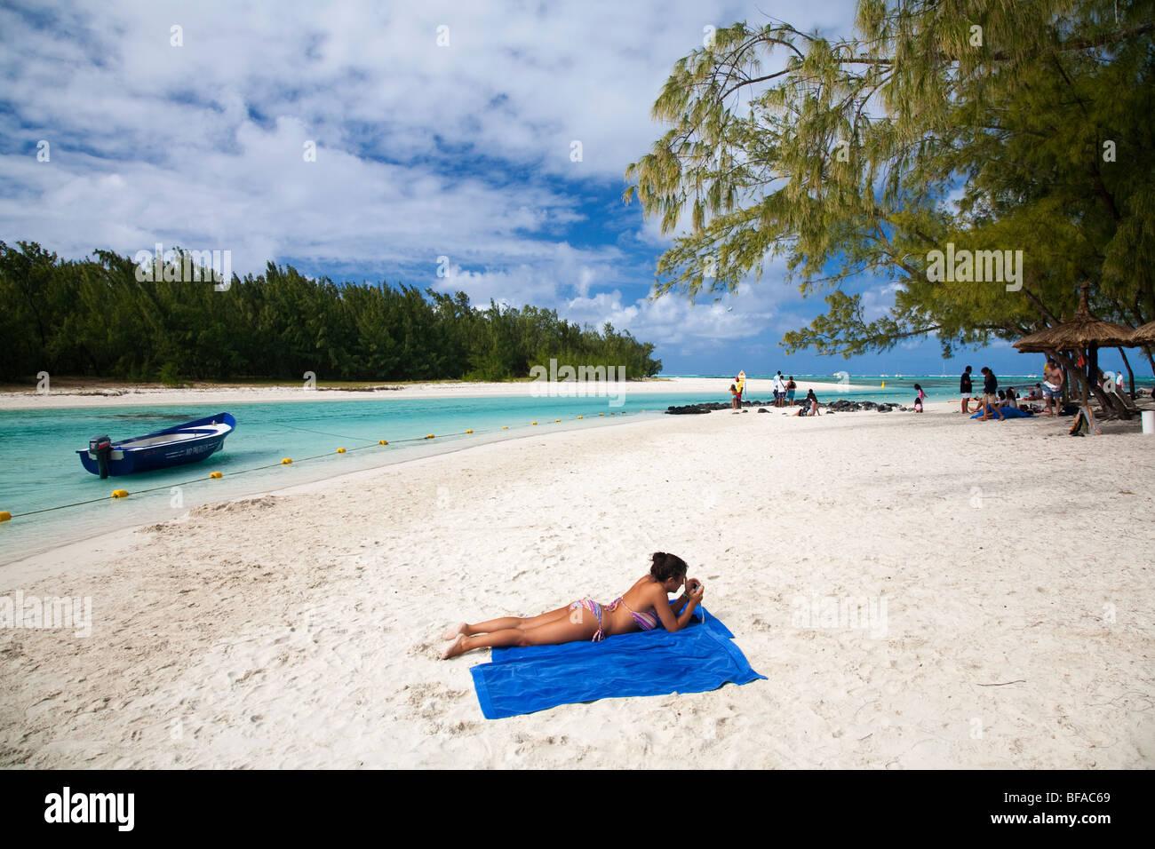 Sunbather at Ile aux Cerfs, Mauritius - Stock Image