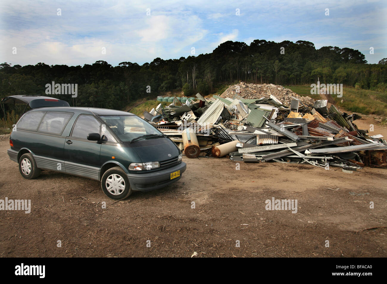 Late model van with metal at dump about to be recycled - Stock Image
