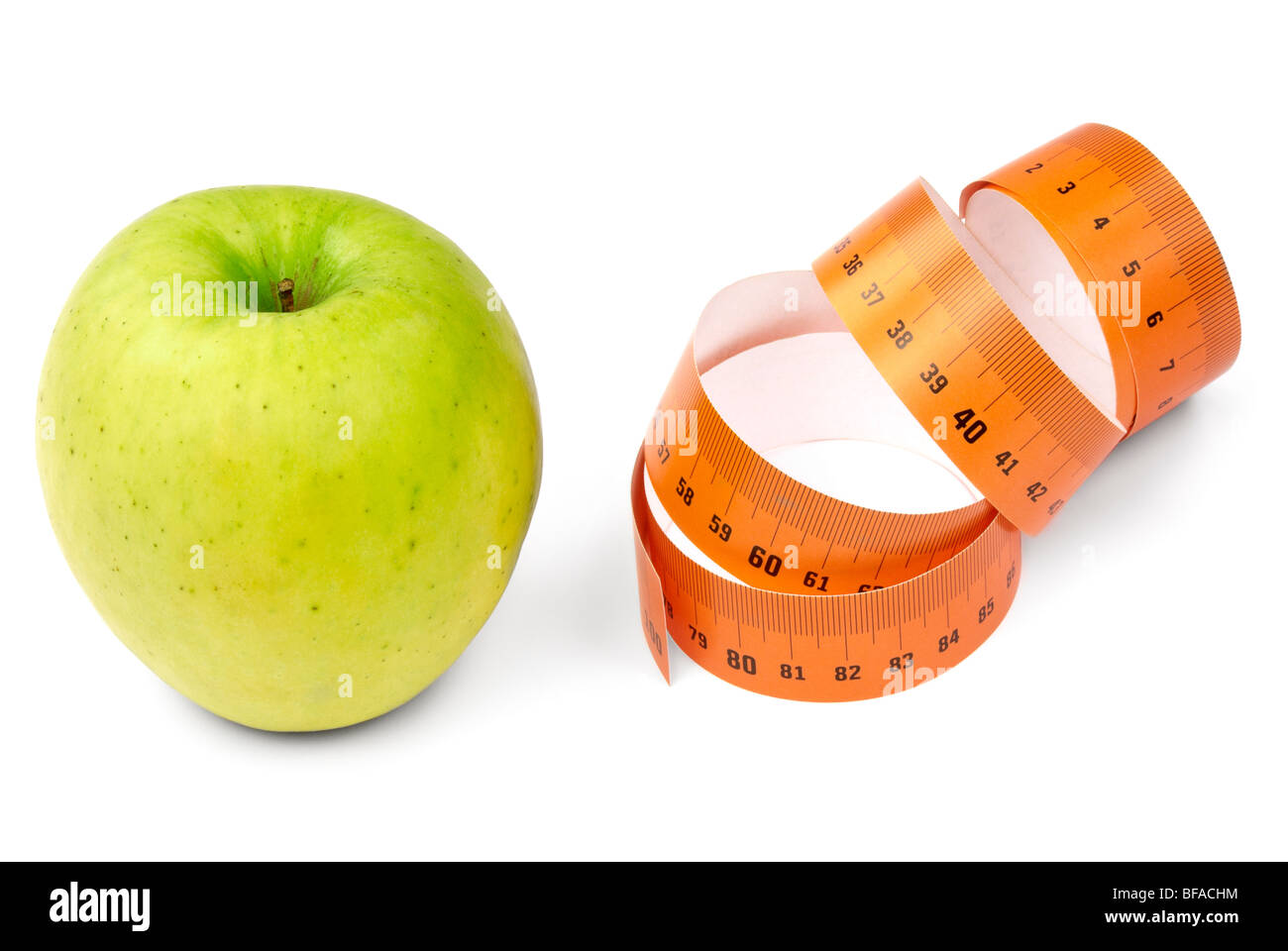 Green apple and orange measurement tape. Diet concept. - Stock Image