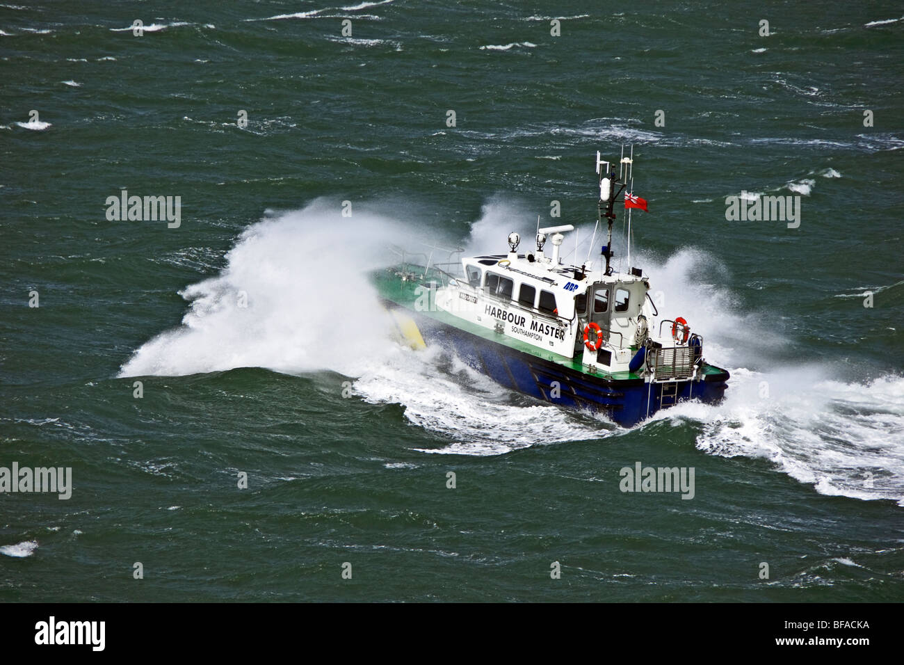 The Southampton pilot boat off Cowes on the Isle of Wight in blustery weather - Stock Image