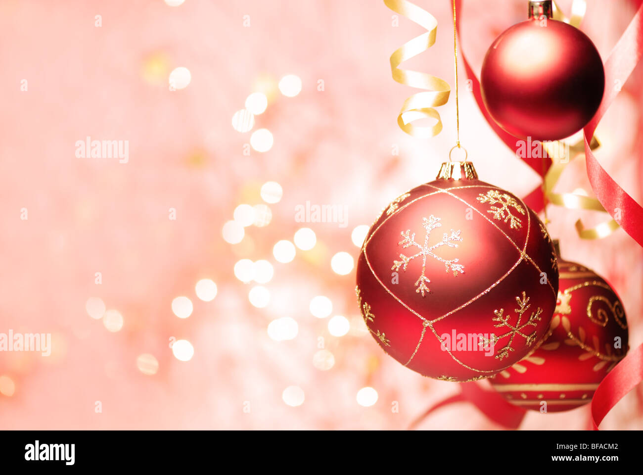 Christmas Decoration-- Red christmas ball and ribbon with abstract light background. - Stock Image