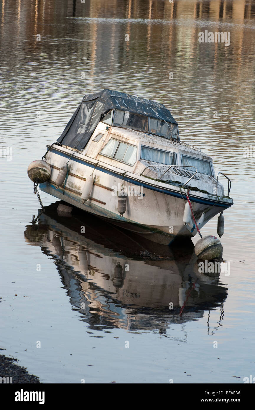 A pleasure boat on the Thames covered in bird droppings at low time. - Stock Image