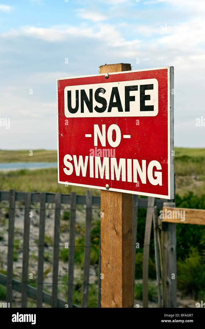 Warning sign of unsafe beach, Nauset Beach, Orleans, Cape Cod, MA, USA Stock Photo