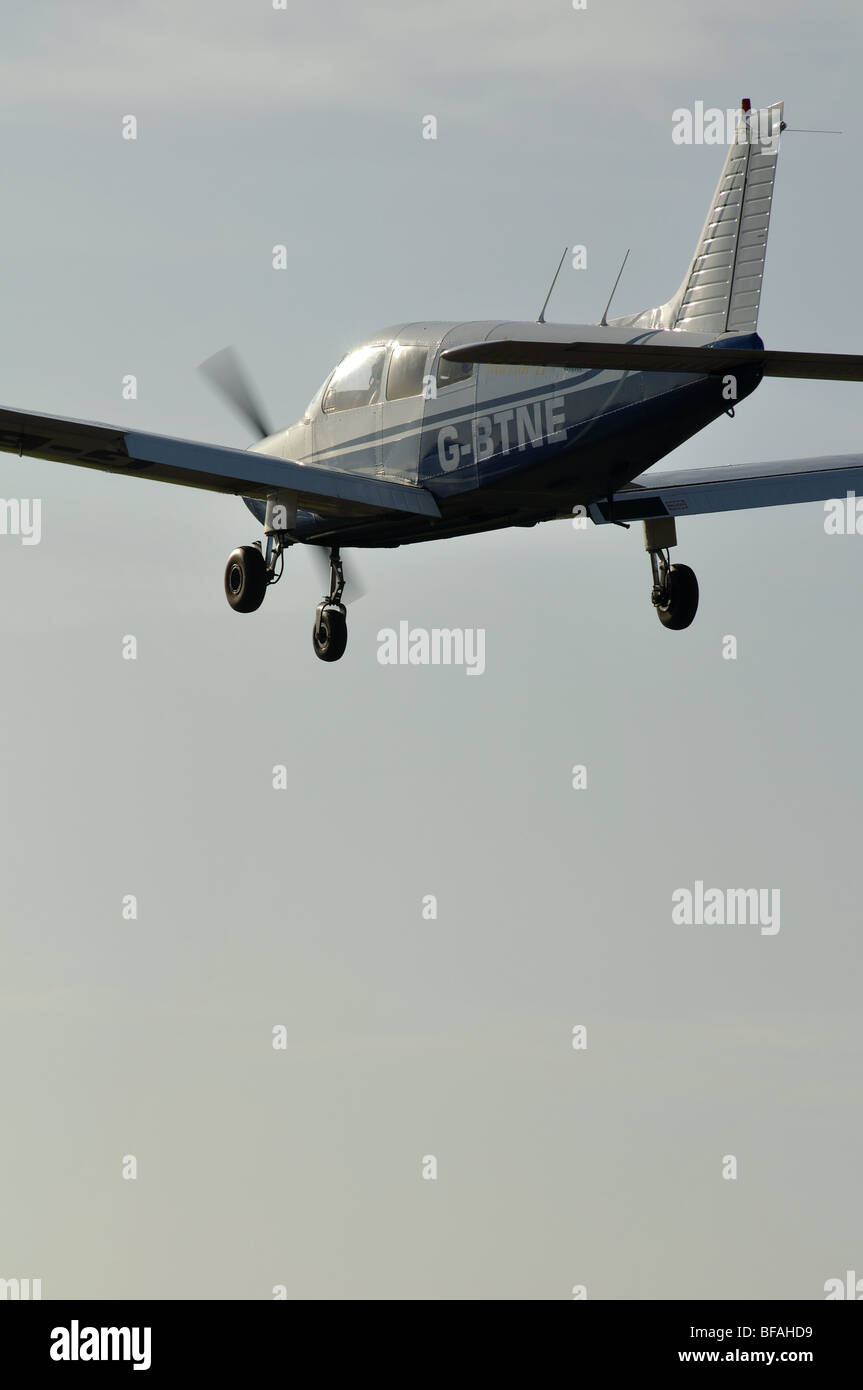 Piper PA28 Warrior aircraft approaching Wellesbourne Airfield, Warwickshire, UK - Stock Image