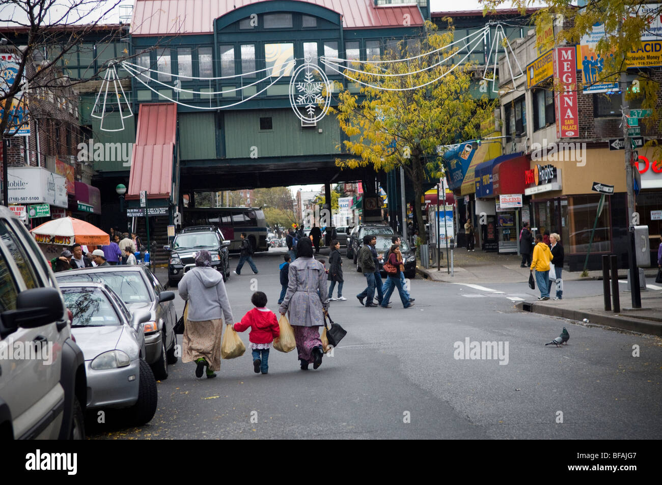 74th Street toward the Flushing subway line in the Queens neighborhood of Jackson Heights in New York - Stock Image