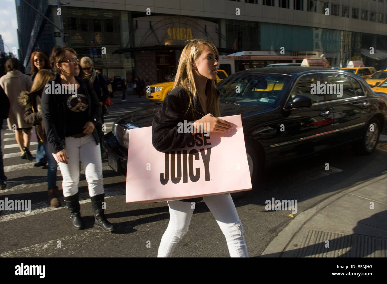 A Juicy Couture shopper in the midtown neighborhood of New York on Tuesday, November 3, 2009. (© Frances M. - Stock Image