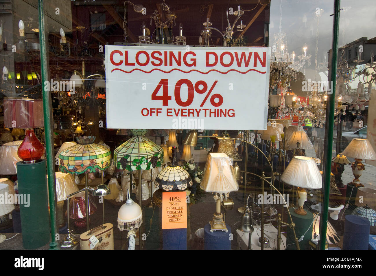 A lighting shop offers a 40% discount as part of its closing down sale. It is a victim of the recession in Britain - Stock Image