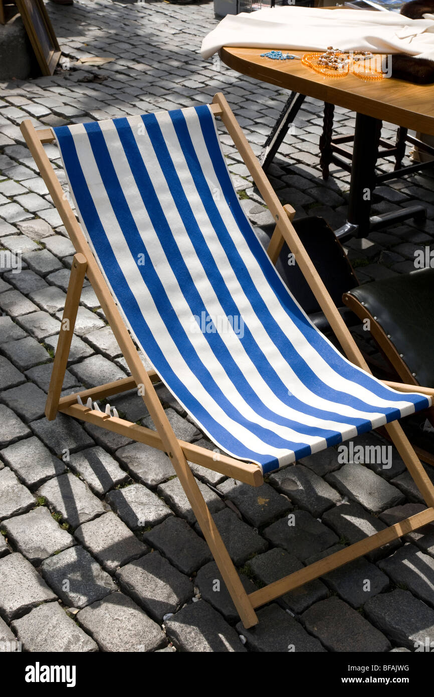 Deck Chair on Cobbled Stones - Stock Image