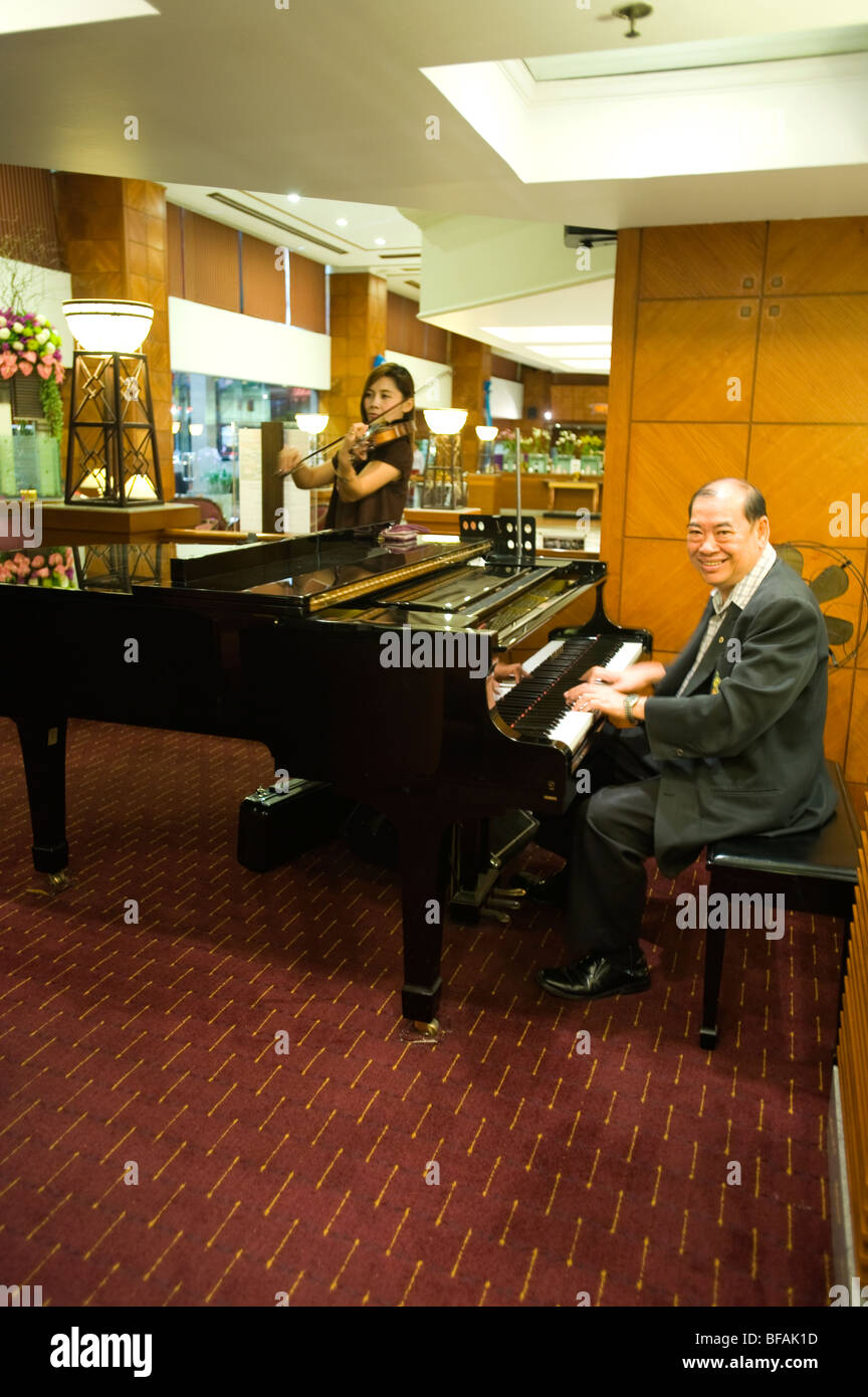 Pianist and Violinist performing in hotel lobby, Bangkok