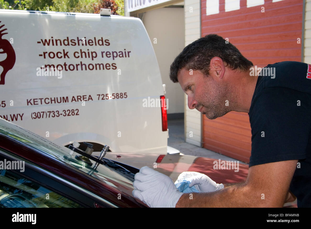 Chipped car windshield being repaired in Boise, Idaho, USA. - Stock Image