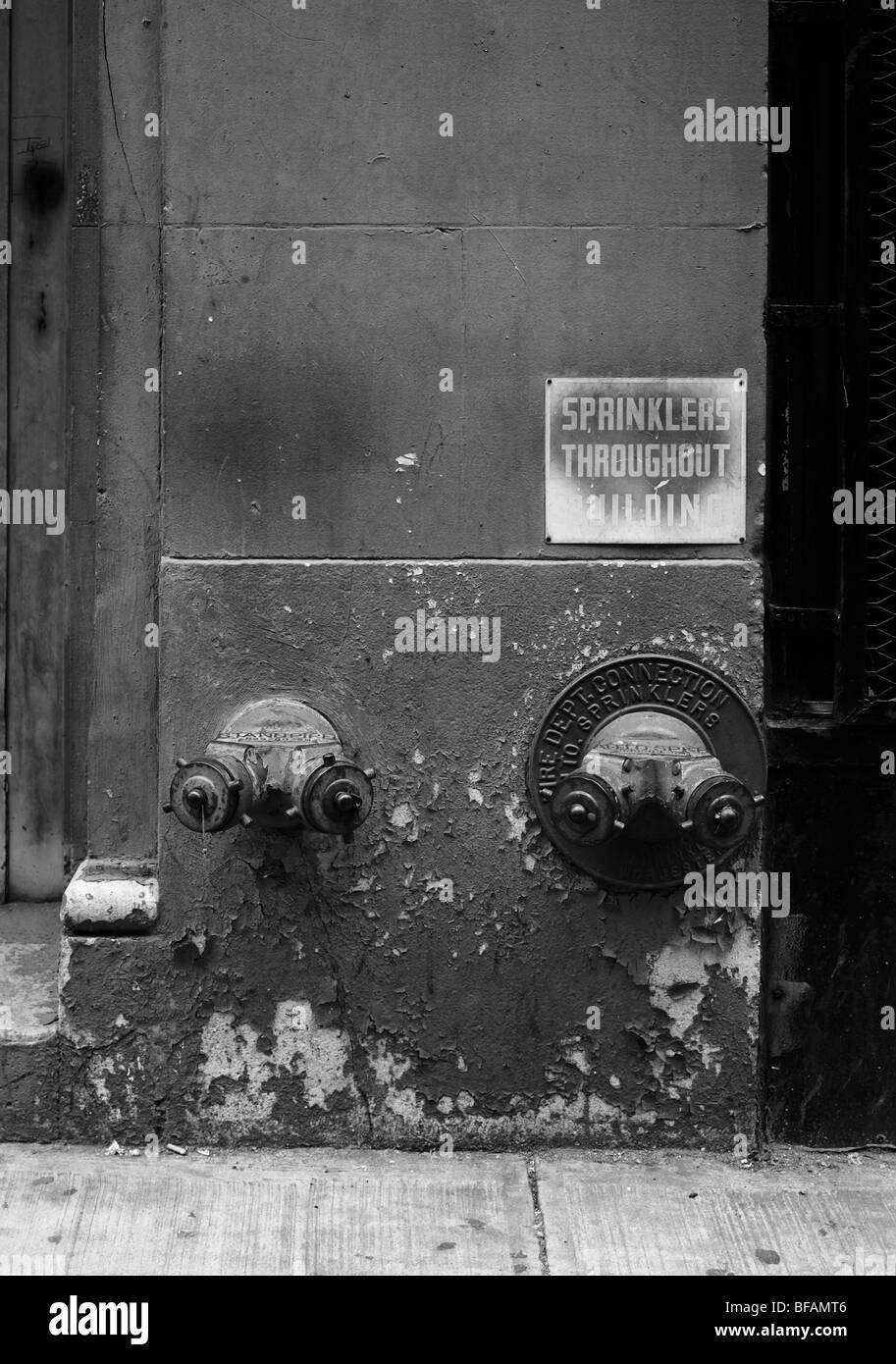 New York, fire sprinkler attachment points on the outside of the building - Stock Image
