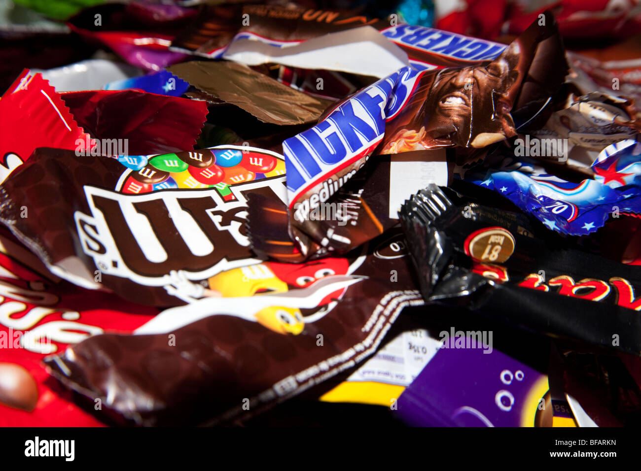 Assorted sweet or candy bar wrappers - Stock Image
