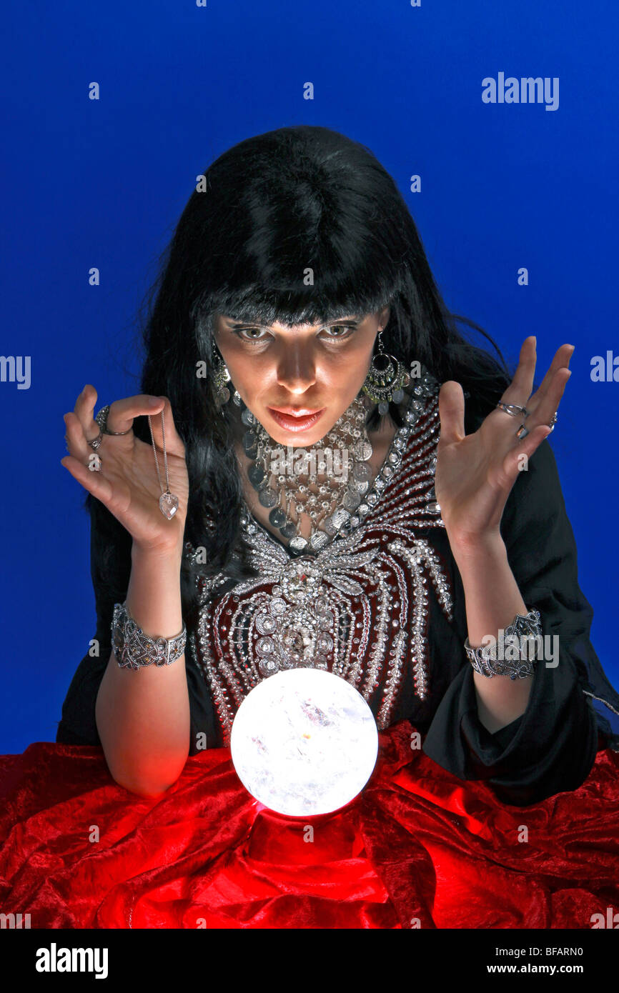 fortune teller with crystal ball and pendulum - Stock Image