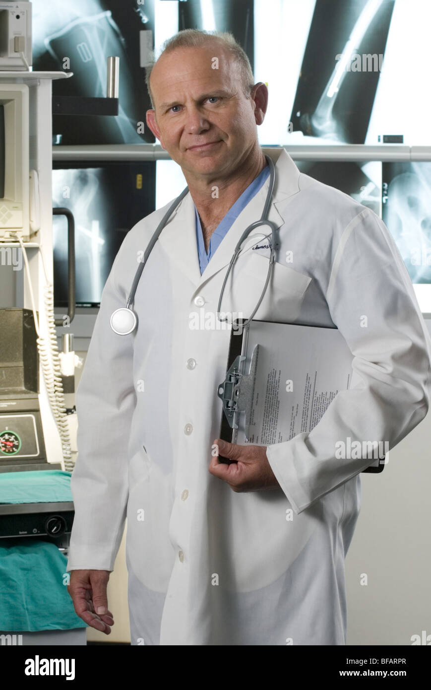 Doctor studio background, portrait, direct to camera - Stock Image