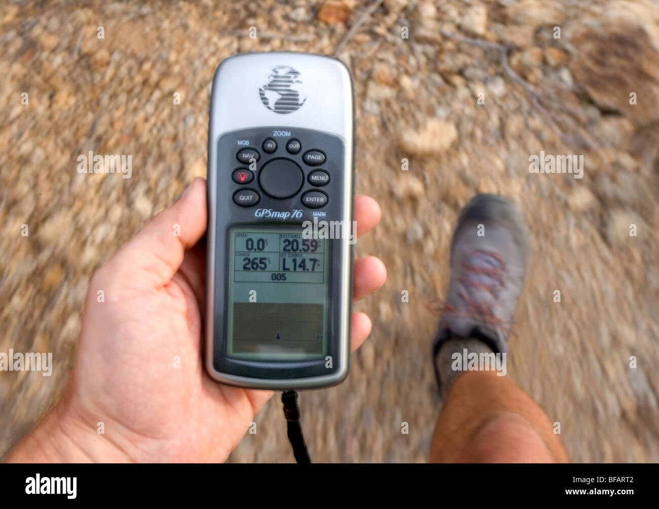 Looking at a GPS while hiking. - Stock Image