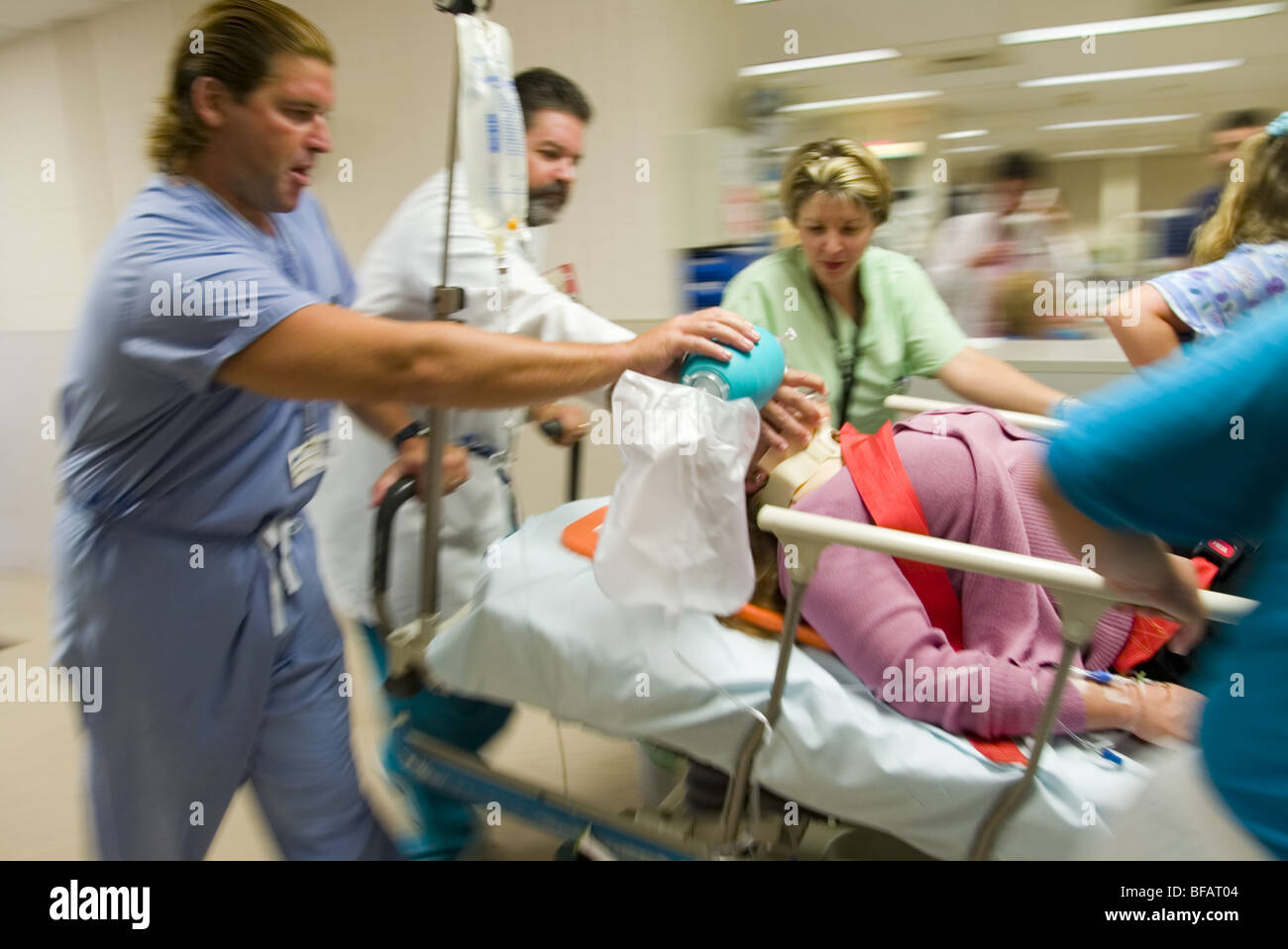 Emergency room, EMTs rush patient to operating room. - Stock Image