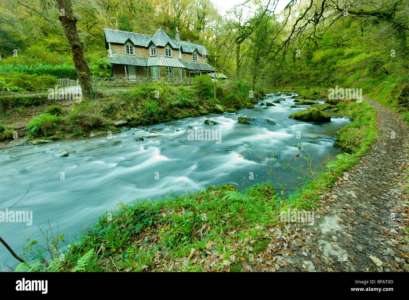 Watersmeet house on the river lyn in full spate after rain, watersmeet National Trust property, Devon - Stock Image
